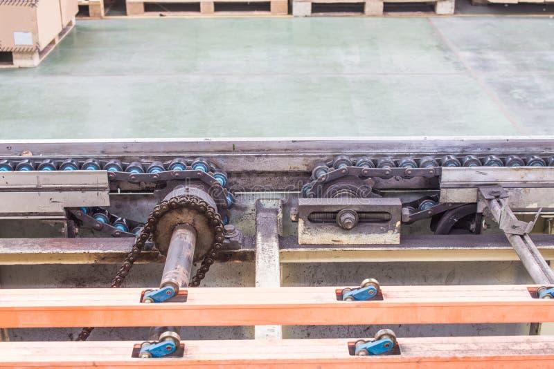 Drevaxeln av linjen transportörsystem arkivfoto