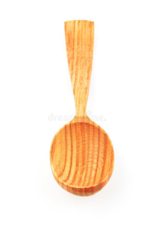 Drewniana łyżka na biało obraz stock