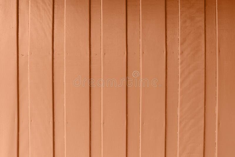 Drewniana ściana z nafcianej farby brązu pomarańczowym kolorem folował teren, ścienny drewno z wodnego koloru pastelowym brązem,  obrazy royalty free