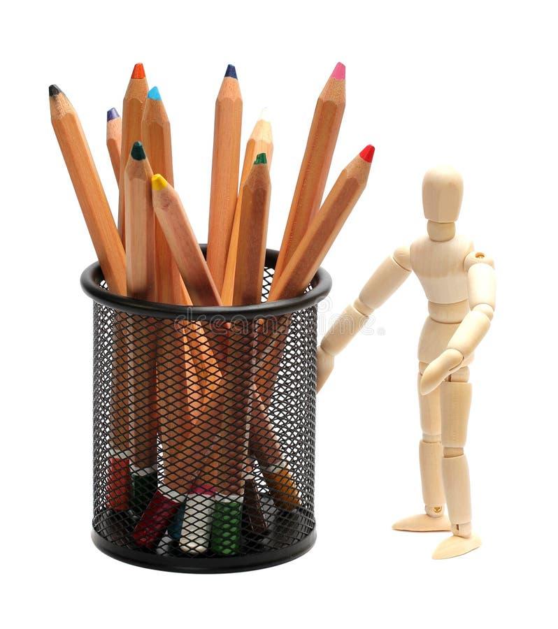 Drewniana lala z ołówkami w garbion klatce zdjęcia royalty free
