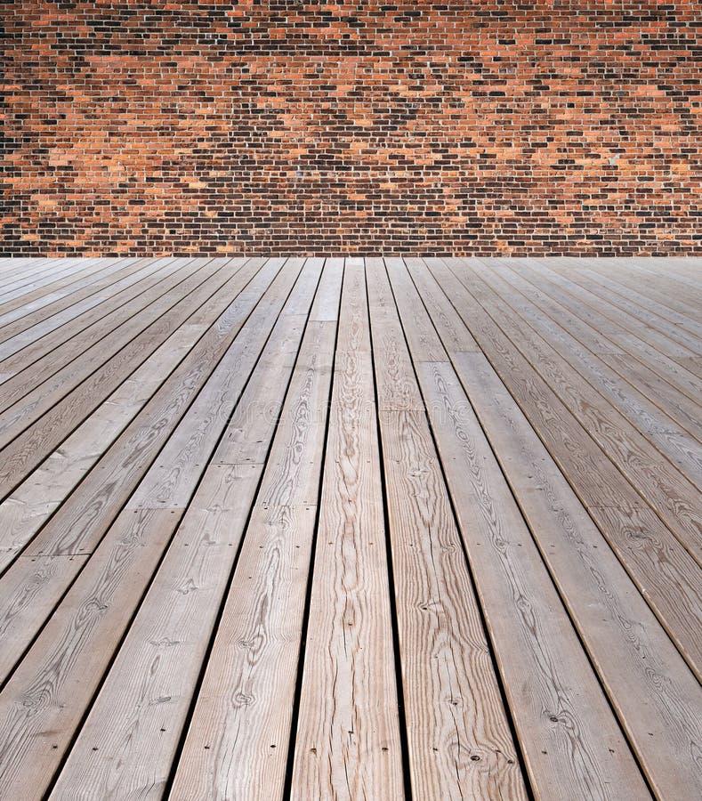Drewniana podłoga i ściana z cegieł zdjęcia stock