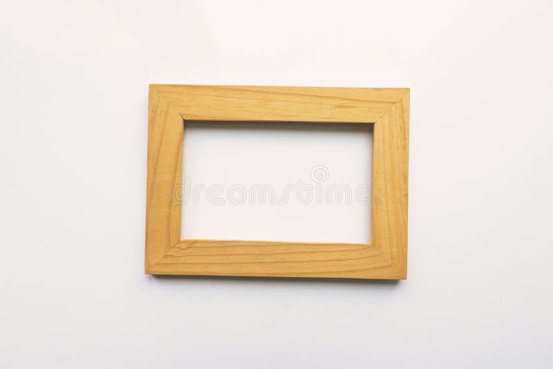 Drewniana prostokątna fotografii rama na białym tle Zakończenie Odgórny widok Nikt, pusty royalty ilustracja