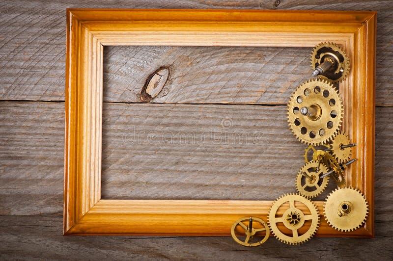 Drewniana rama i machinalny zegar zdjęcie royalty free