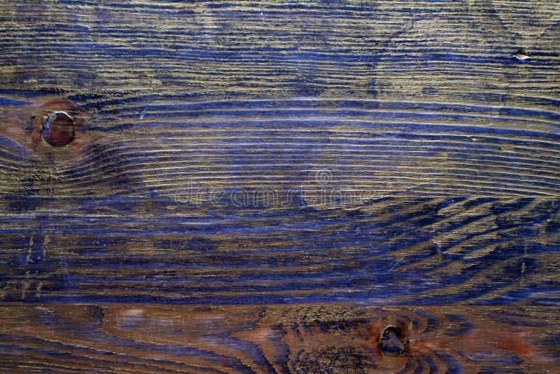 Drewniana tekstura taktująca z heban plamą i złocistą farbą zdjęcie royalty free