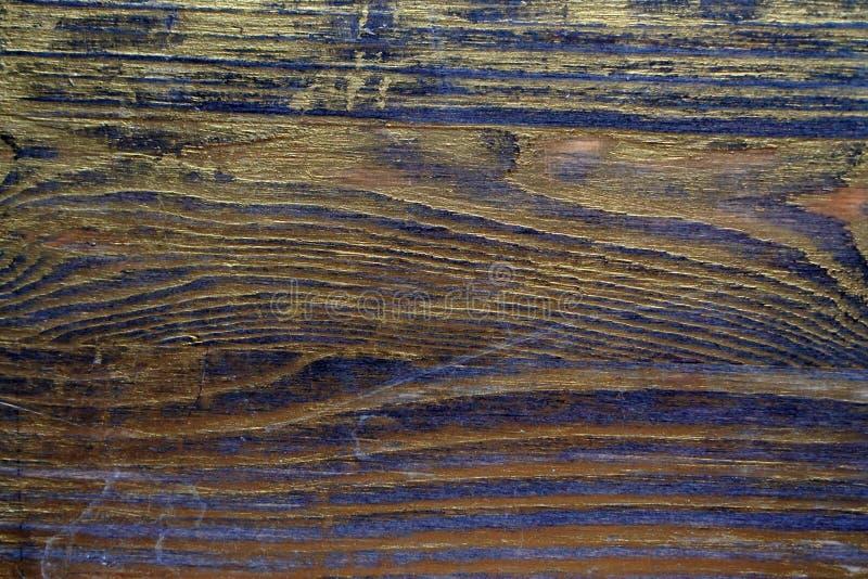 Drewniana tekstura taktująca z heban plamą i złocistą farbą zdjęcia stock