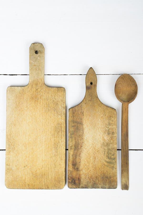 Drewniana tnąca deska i łyżka obrazy royalty free