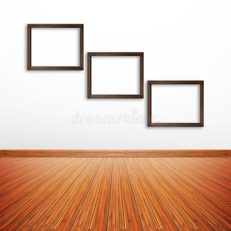 Drewniane fotografii ramy na biel ścianie wśrodku pokoju ilustracji