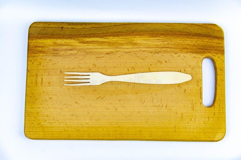 Drewniane ?y?ki na drewnianej tn?cej desce obraz stock