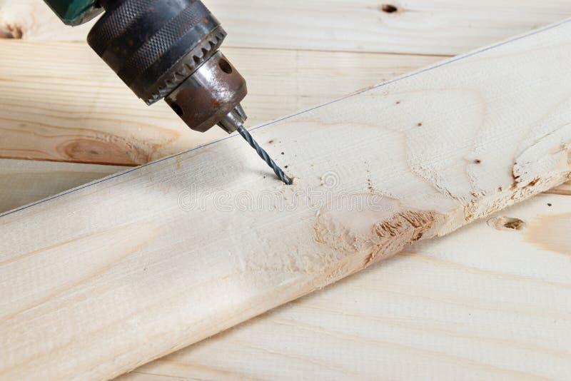 Drewniany świder z dokrętką, pojęć Drewniani pracujący narzędzia obrazy royalty free