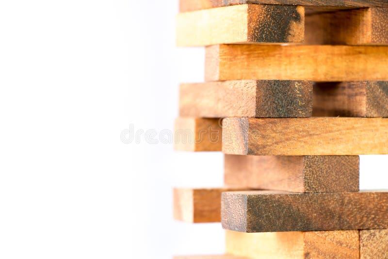 Drewniany blok broguje up jak wierza na białym tle obraz royalty free