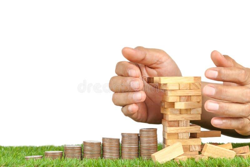 Drewniany blokowy jenga i moneta fotografia royalty free