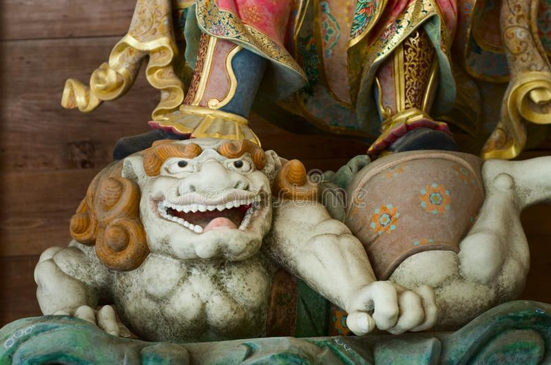 Drewniany deamon w Buddyjskiej świątyni zdjęcie stock