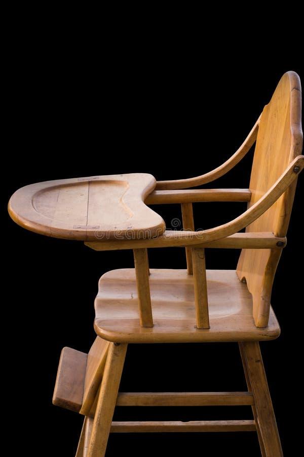 Drewniany highchair czerni tło obraz stock