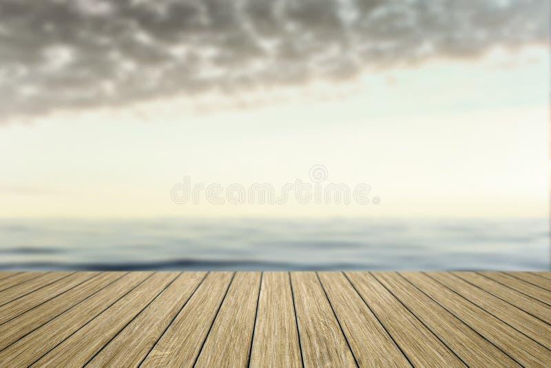 drewniany jetty z zamazanym oceanu tłem obraz stock