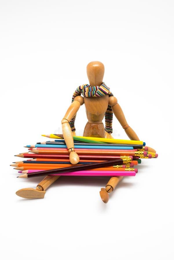 Drewniany mannequin z kolorowymi farbami szko?a, z powrotem obraz stock