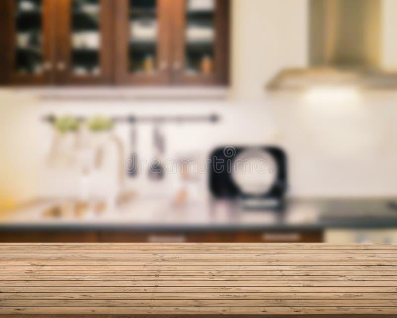 Drewniany odpierający wierzchołek z kuchennym tłem zdjęcia royalty free