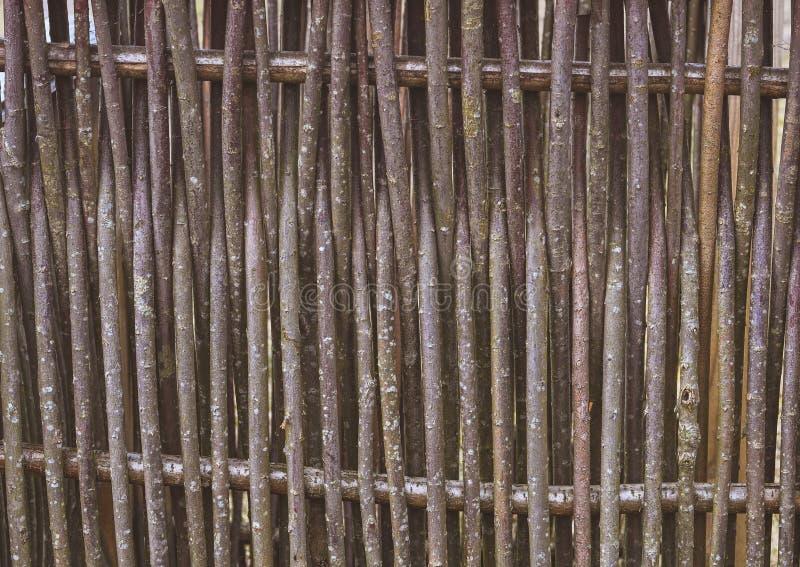 Drewniany ogrodzenie robić cienkie stare gałąź w rocznika stylu obraz royalty free