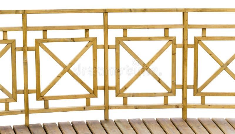 Drewniany ogrodzenie z poręczem na bielu zdjęcia royalty free