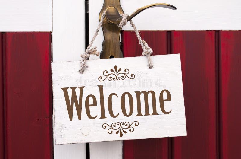 Drewniany signboard z wiadomości powitaniem zdjęcia royalty free