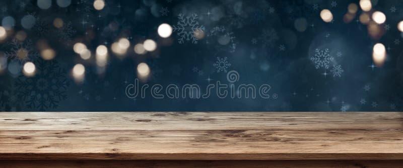 Drewniany stół z zmrokiem - błękitny bożego narodzenia tło zdjęcia stock