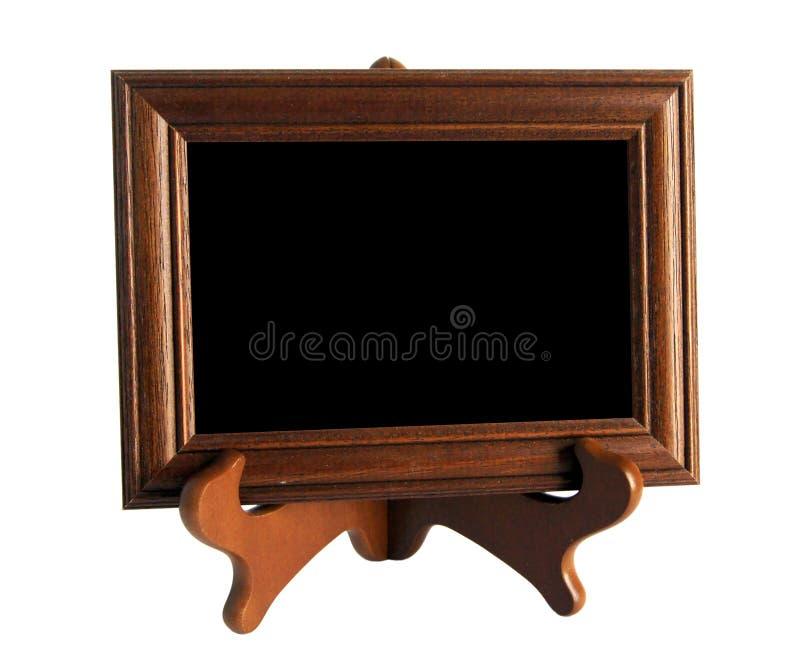 Drewniany stojak z obrazek ramą odizolowywającą na bielu obraz royalty free