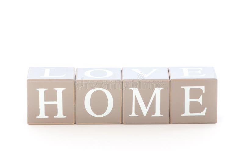 Drewniany sześcianu dowcip słowo dom literujący zdjęcie stock