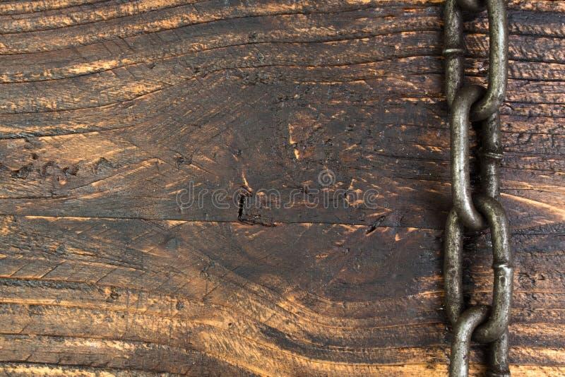 Drewniany tło z łańcuchem Odbitkowa przestrzeń dla teksta obraz stock