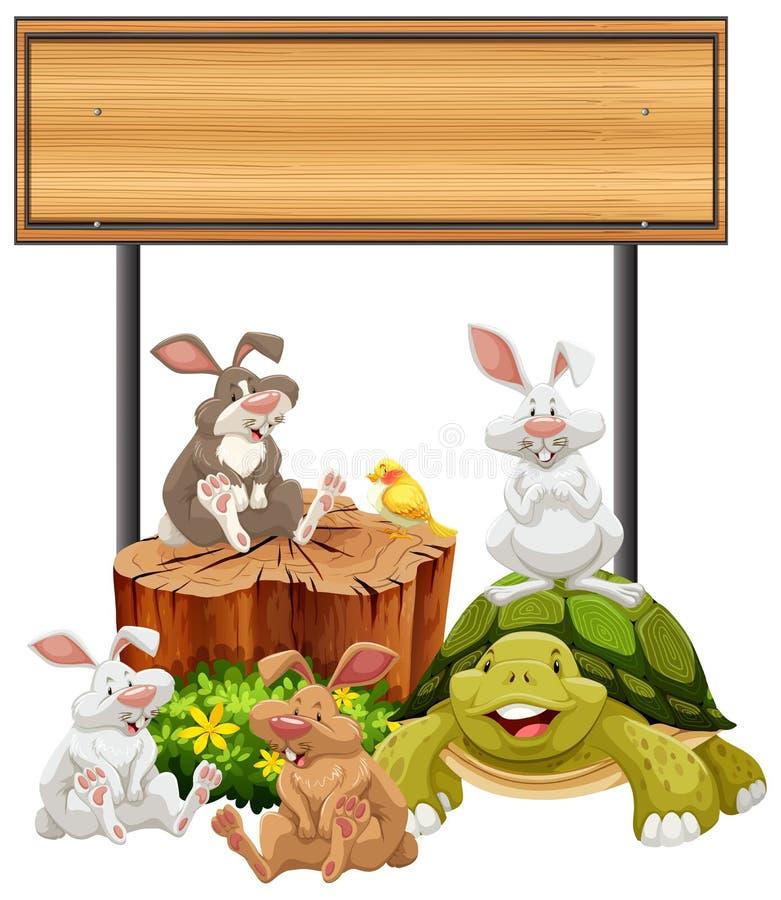 Drewniany znak z królikami i żółwiem ilustracji