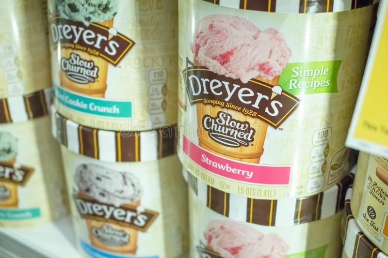 Dreyer`s Ice cream at the store. Several varieties of Dreyer`s Slow Churned Ice Cream containers in the freezer section of a local grocery store royalty free stock photography