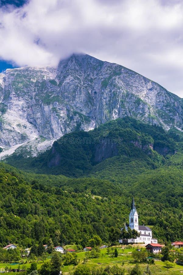 Dreznica church under Julian Alps in Triglav Park, Slovenia.  royalty free stock photos