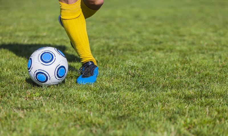Dribbling. Close-up image of the feet of a soccer player dribbling stock photography