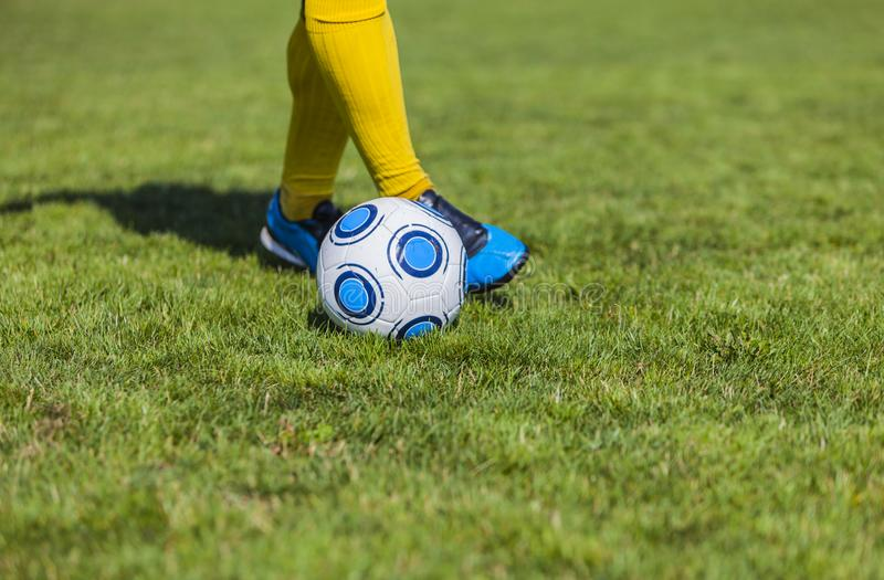 Dribbling. Close-up image of the feet of a soccer player dribbling. Focus on the ball stock images