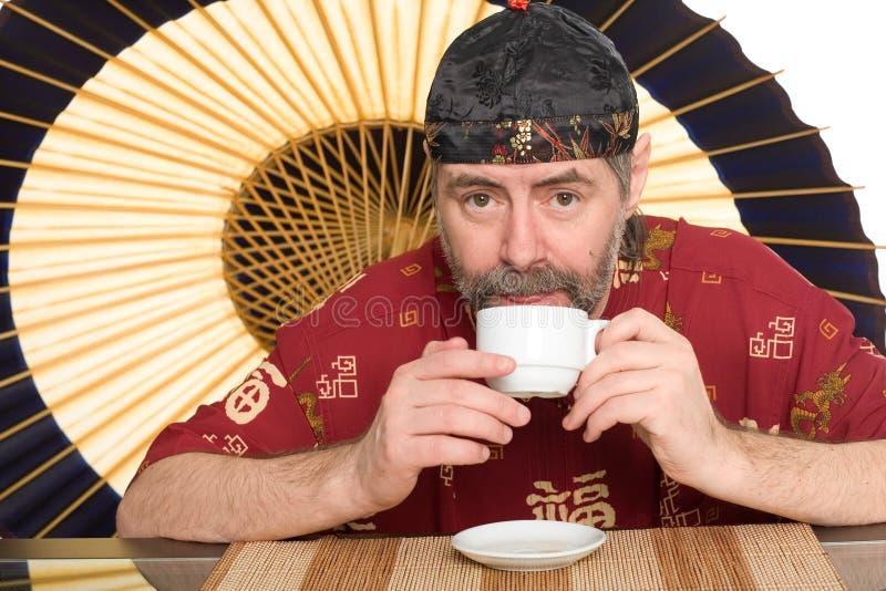dricka mantea för kinesisk dräkt royaltyfria bilder