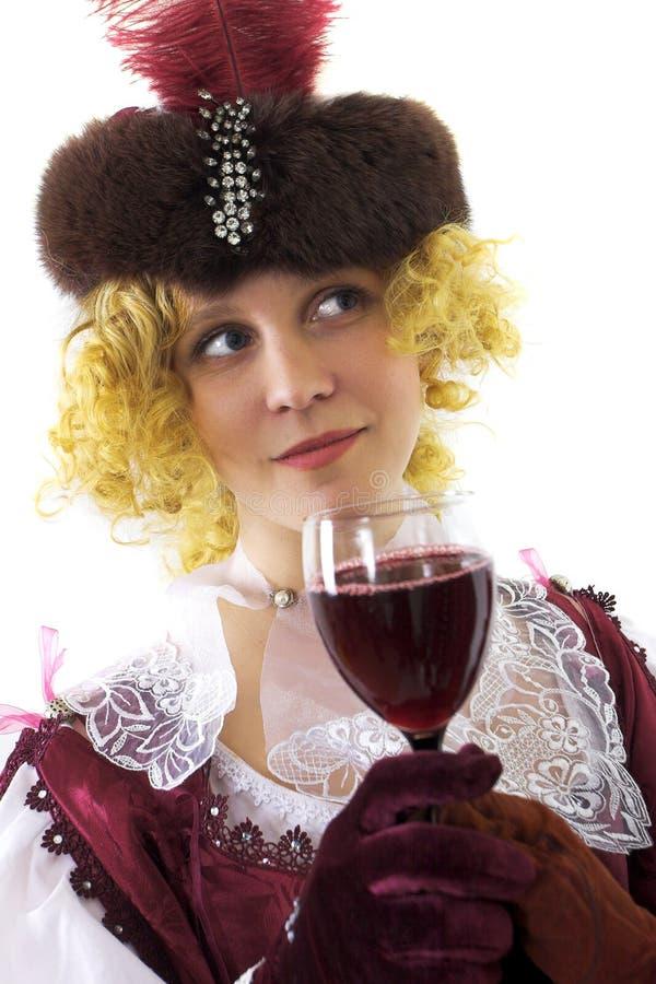 dricka rött vinkvinna arkivfoto