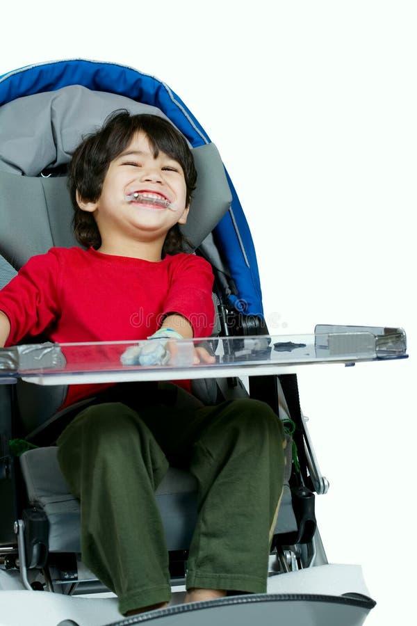Drie éénjarigen biracial gehandicapte jongen in medische gelukkige wandelwagen, royalty-vrije stock afbeeldingen