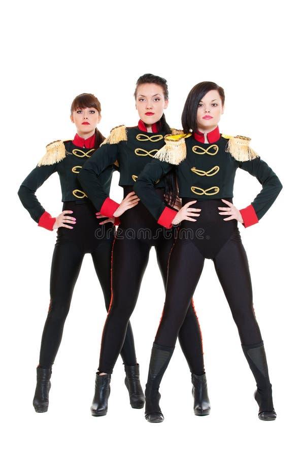 Drie aantrekkelijke dansers in kostuums royalty-vrije stock afbeelding