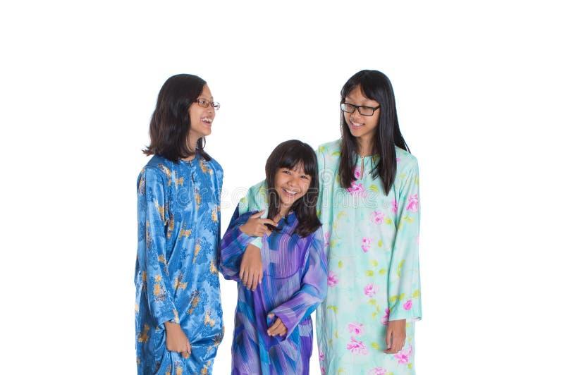 Drie Aziatische Maleisische Tienerzusters II stock foto's