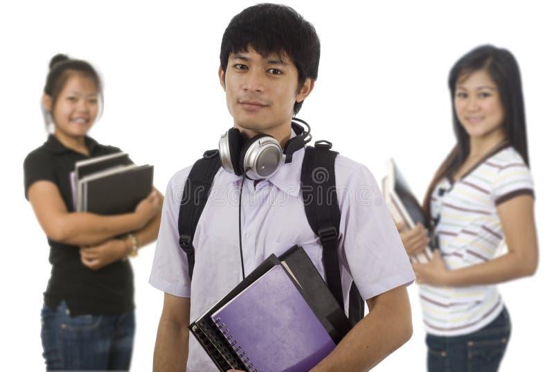 Drie Aziatische studenten stock foto