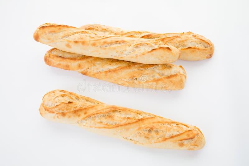 3 drie baguettes kochten het vierde wordt aangeboden stock foto