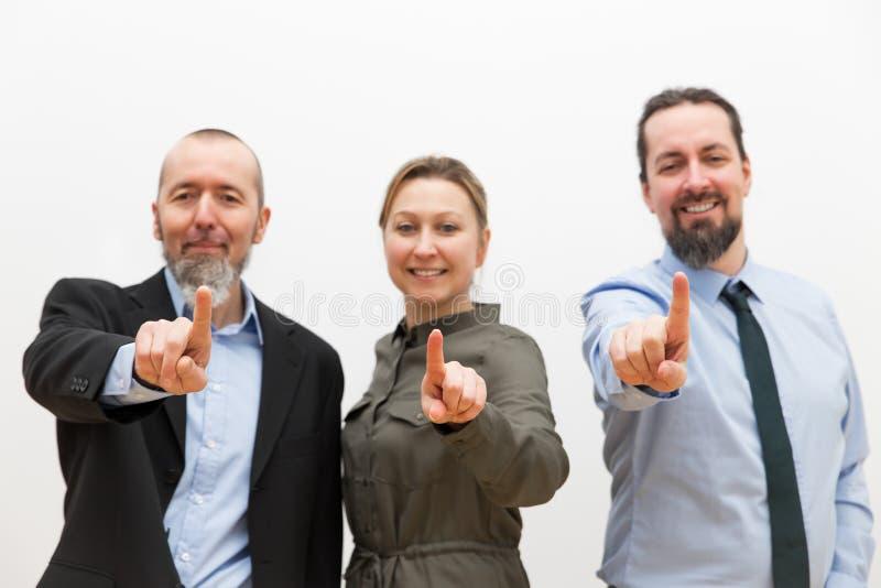 Drie bedrijfsarbeiders royalty-vrije stock afbeeldingen