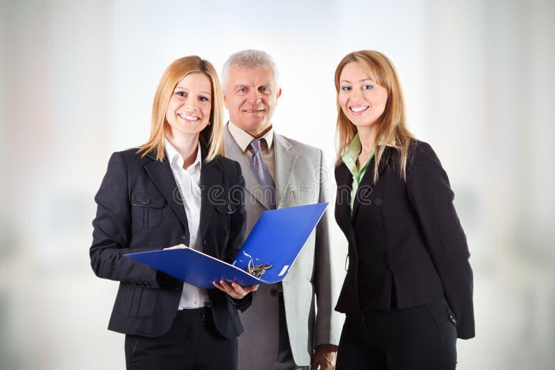 Drie bedrijfsmensen stock foto's