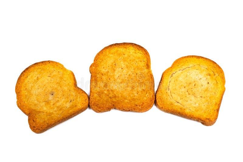 Drie beschuiten van wit brood op een witte achtergrond stock foto