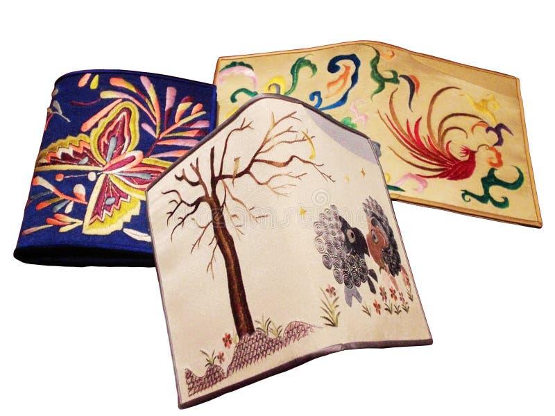 Drie borduurwerkportefeuille met schapen, vlinder royalty-vrije stock foto