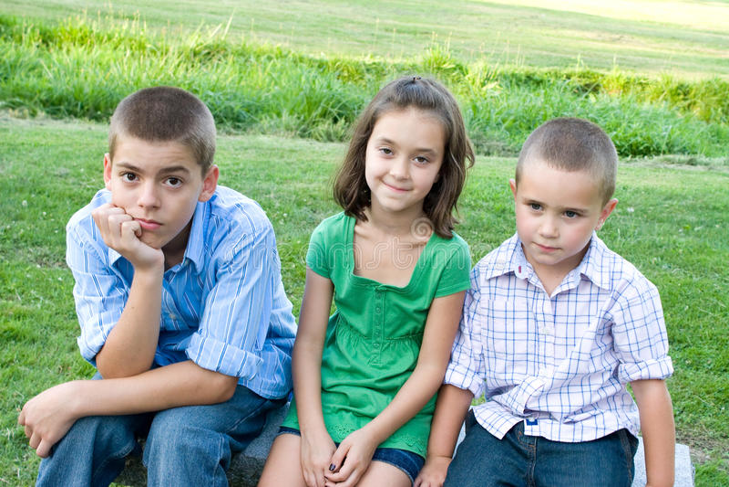 Drie Bored Jonge geitjes royalty-vrije stock foto