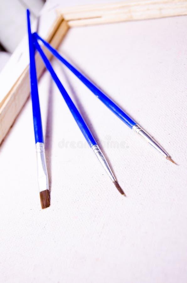 Drie borstels Het trekken van reeks brancard canvas Boom stock afbeeldingen