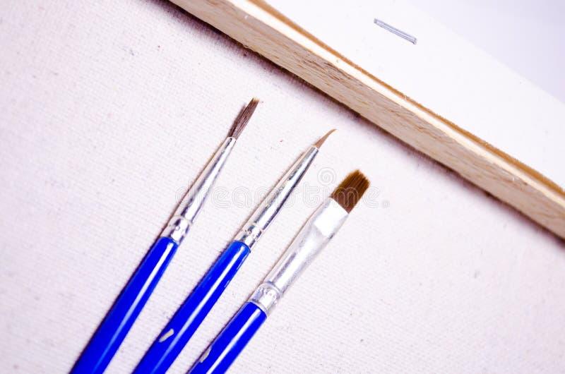 Drie borstels Het trekken van reeks brancard canvas Boom stock afbeelding