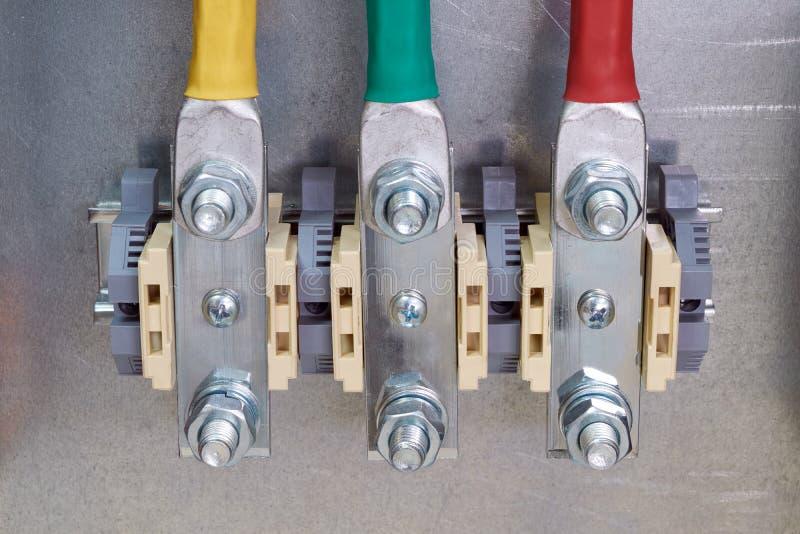 Drie bout-door terminals in het elektrokabinet stock afbeelding
