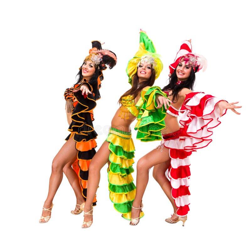 Drie Carnaval dansers het stellen stock foto's