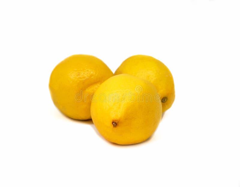 Drie citroenen op de witte achtergrond stock foto's