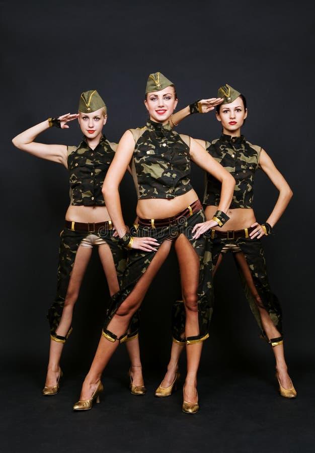 Drie dansers in militaire eenvormig royalty-vrije stock afbeelding
